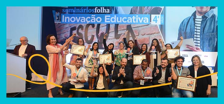 Imagem mostra grupo de educadores comemorando no palco durante a premiação do Desafio Inova Escola
