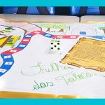 Imagem mostra jogo de tabuleiro Batalha das Tabocas