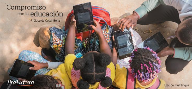 Imagem aérea mostra crianças usando tablets do programa ProFuturo que reafirma seu compromisso com a educação de qualidade.