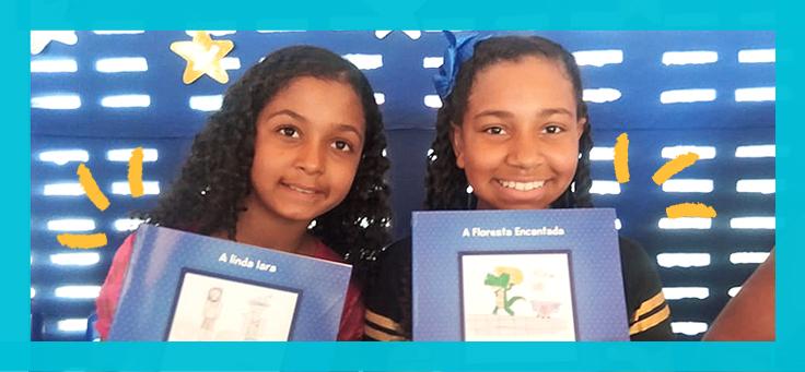 Imagem mostra duas meninas segurando livros