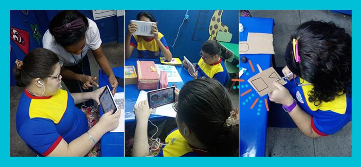 Imagem mostra crianças dentro da sala de aula manuseando tablets do projeto Aula Digital