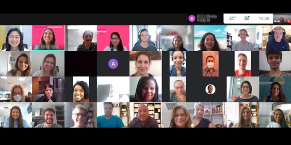 Tela dividida em 36 frames mostra o rosto de voluntários e jovens do Instituto Ana Rosa em sala virtual durante ação da Semana dos Voluntários