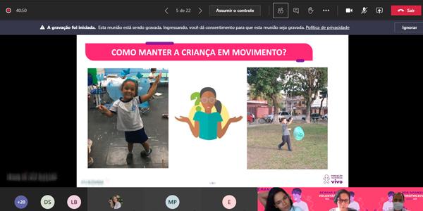 """Tela mostra slide com fotos de duas crianças e o os dizeres """"como manter a criança em movimento"""" durante oficina a distância na Escola Municipal República da Colômbia na Semana dos Voluntários."""