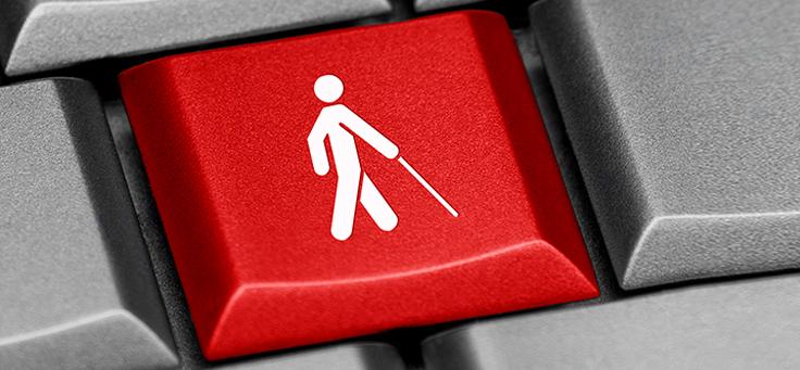 Imagem mostra um símbolo de um bonequinho usando muleta em uma tecla no computador