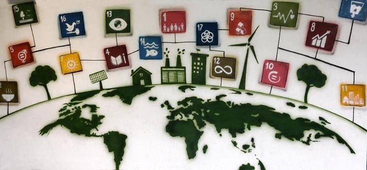 Imagem mostra ícones que representam os ODS (Objetivos de Desenvolvimento Sustentável) da ONU desenhados em torno de um mapa-mundi.