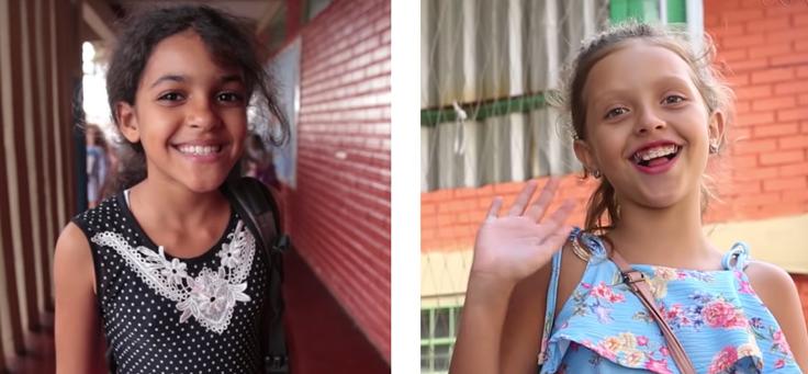 Imagens do vídeo do Dia do Estudante mostram 2 meninas sorrindo para a câmera.