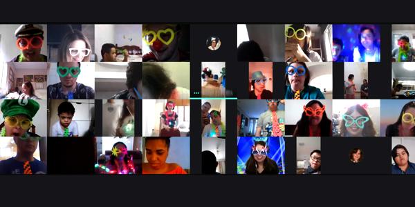 Imagem mostra frames de telas de computadores com o rosto de 24 voluntários e beneficiários da Associação para o Desenvolvimento Integral do Down (ADID) durante a Semana dos Voluntários.