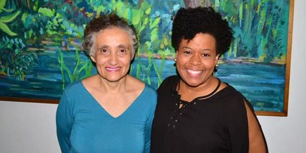 As pesquisadoras Ester Cerdeira Sabino e Jaqueline Goes de Jesus posam para foto