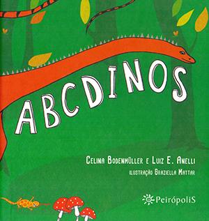 ABCDinos é um dos livros didáticos indicados pela biblioteca do Portal TRILHAS; a capa tem fundo verde que remete a vegetação de uma floresta e em destaque um dinossauro laranja e de pescoço bem comprido.